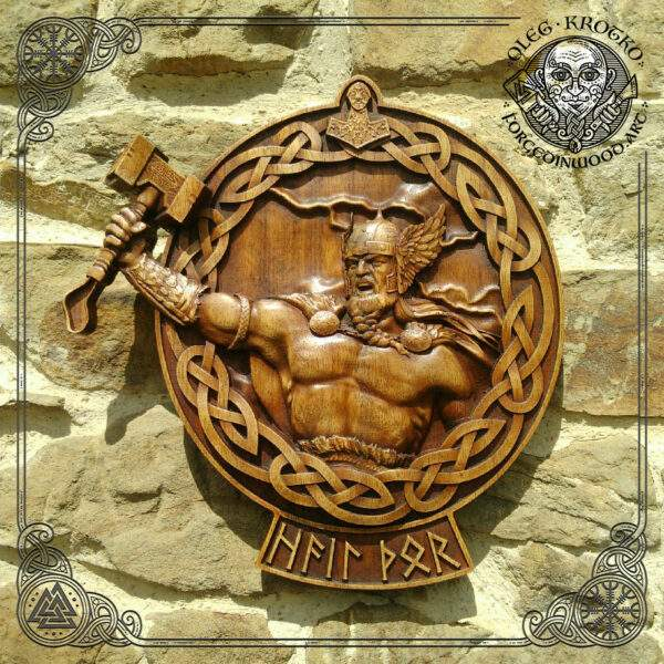 Thor with Mjolnir in round frame wood carving