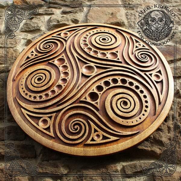 Triskelion hand carved wood art
