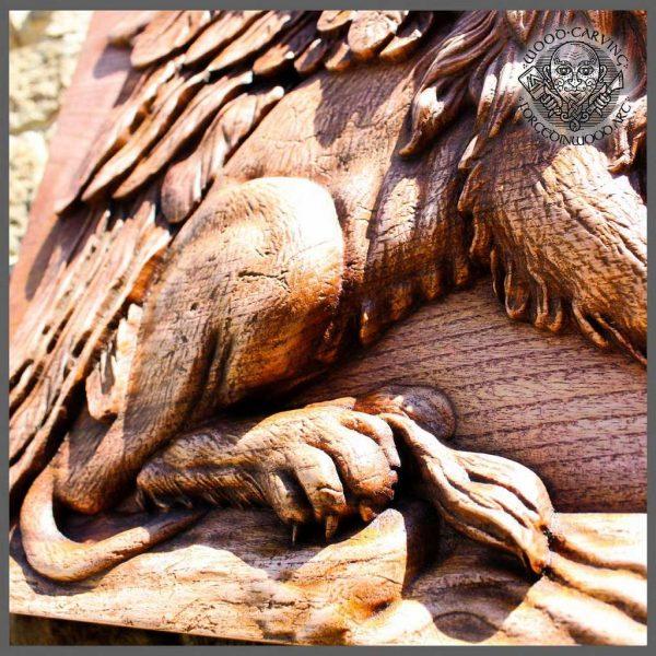 Wildlife lion wood carving
