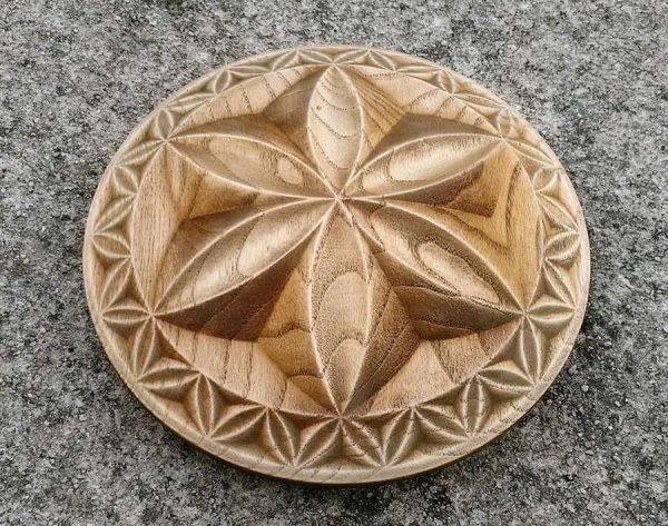 Wood carved Triskelion